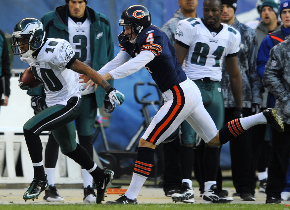 Chicago Bears punter Brad Maynard (4) forces Philadelphia Eagles wide receiver DeSean Jackson (10) out of bounds to save a would-be Eagles touchdown off of a punt during a game on Sunday, Nov. 28, 2010, at Soldier Field in Chicago. Chicago won 31-26.