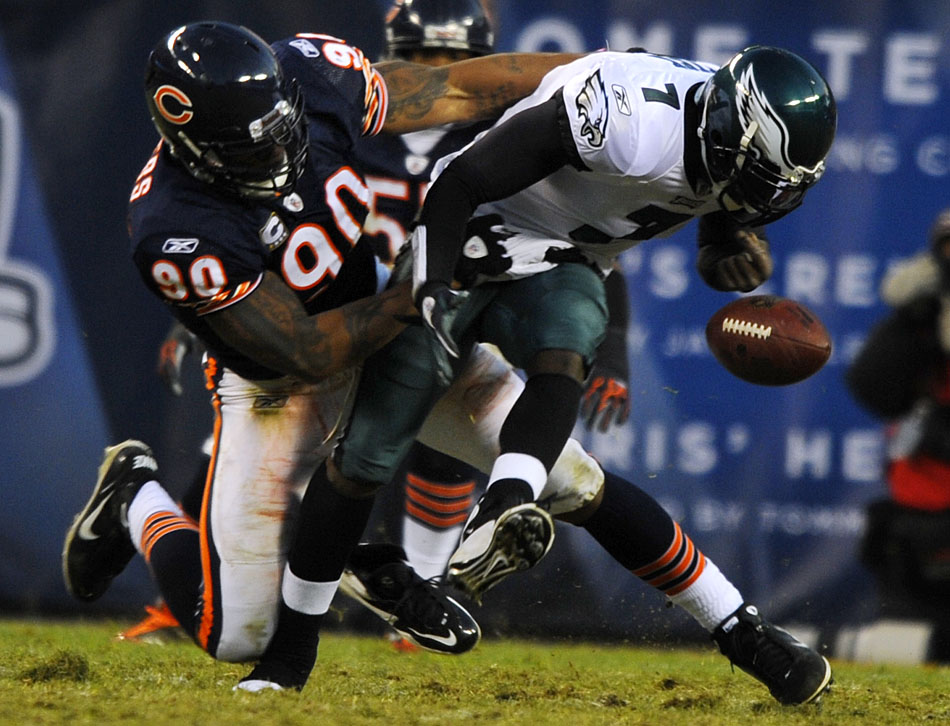 Philadelphia Eagles quarterback Michael Vick (7) fumbles the ball as he's sacked by Chicago Bears defensive end Julius Peppers (90) during the first half of a game on Sunday, Nov. 28, 2010, at Soldier Field in Chicago.