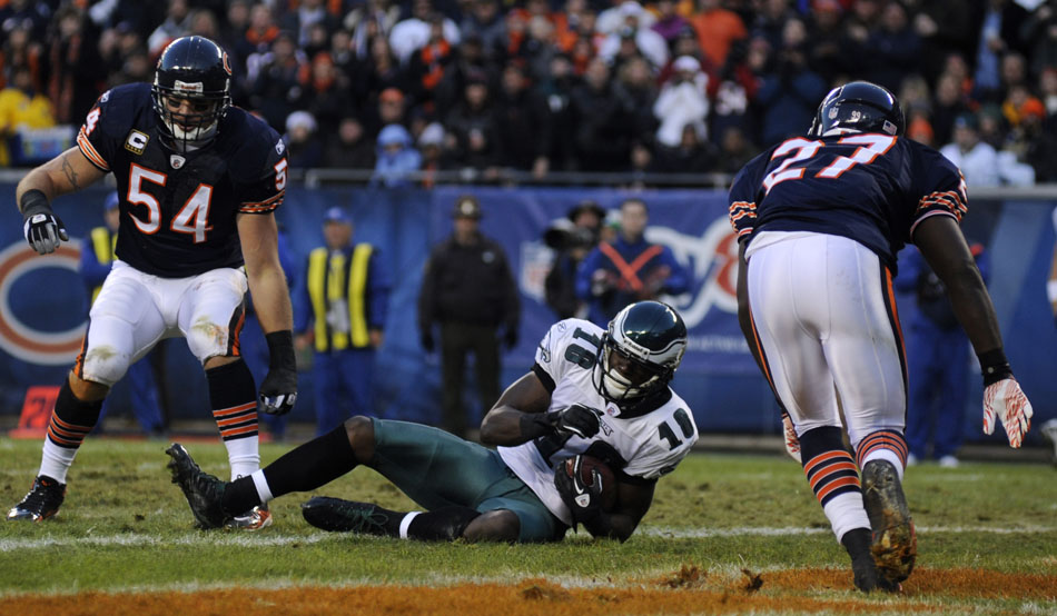 Philadelphia Eagles wide receiver Jeremy Maclin (18) catches a touchdown between Chicago Bears linebacker Brian Urlacher (54) and safety Major Wright (27) during a game on Sunday, Nov. 28, 2010, at Soldier Field in Chicago.
