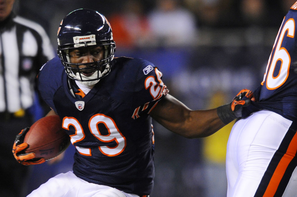 Chicago Bears running back Chester Taylor (29) runs the ball behind a blocker during a game on Sunday, Nov. 28, 2010, at Soldier Field in Chicago.