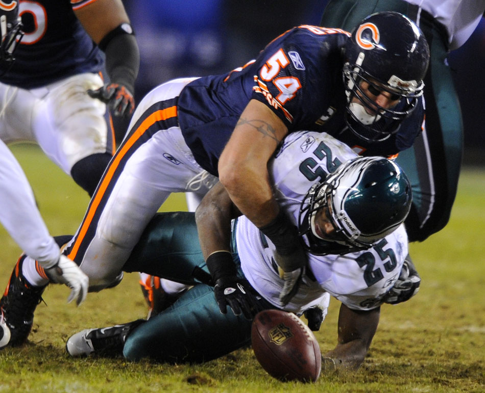 Philadelphia Eagles running back LeSean McCoy (25) fumbles the ball after a hit from Chicago Bears linebacker Brian Urlacher (54) during a game on Sunday, Nov. 28, 2010, at Soldier Field in Chicago.
