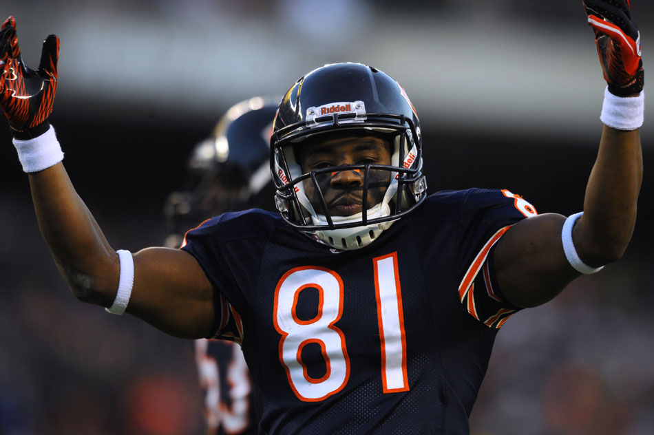 Chicago Bears wide receiver Rashied Davis (81) pumps up the crowd before a kick off during a game on Sunday, Nov. 28, 2010, at Soldier Field in Chicago.