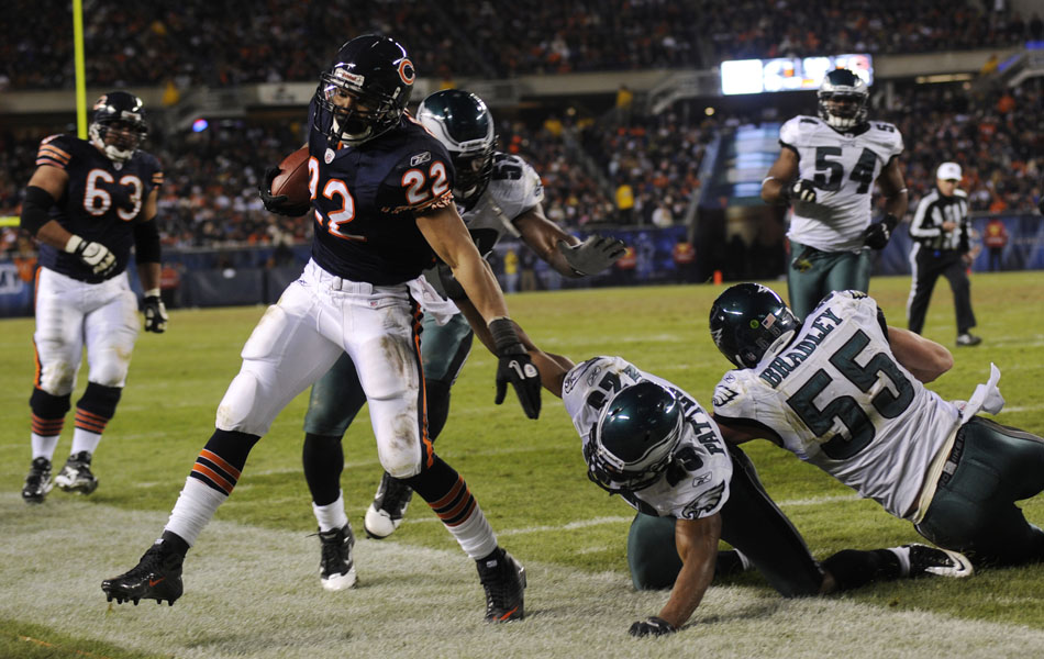 Philadelphia Eagles cornerback Dimitri Patterson (23) and linebacker Stewart Bradley (55) force Chicago Bears running back Matt Forte (22) out of bounds during a game on Sunday, Nov. 28, 2010, at Soldier Field in Chicago.