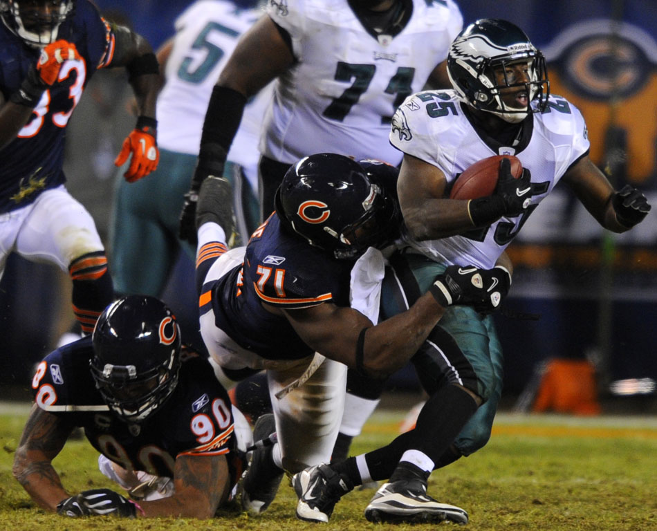 Chicago Bears defensive tackle Israel Idonije (71) tackles Philadelphia Eagles running back LeSean McCoy (25) during a game on Sunday, Nov. 28, 2010, at Soldier Field in Chicago.