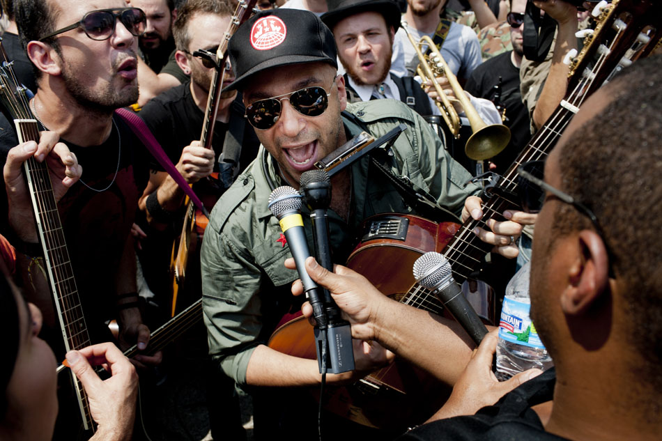 Tom Morello, the former Rage Against the Machine guitarist, performs during a NATO Summit Protest on Sunday, May 20, 2012, at Grant Park in Chicago. Despite pleas from organizers, Morello insisted on performing amidst a large group of people. (Photo by James Brosher)