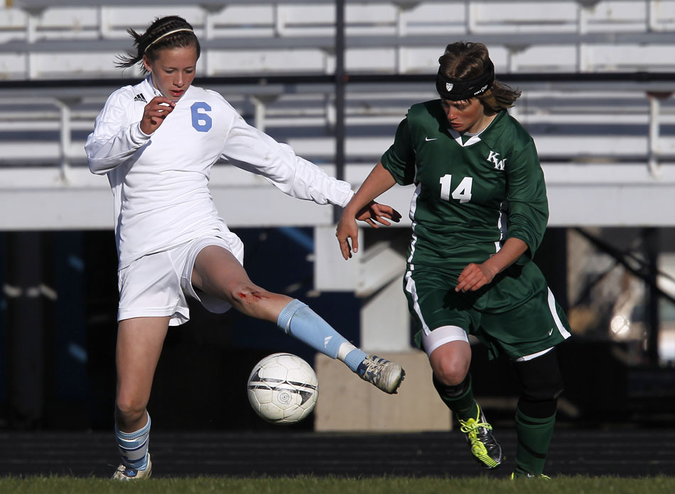 Cheyenne East's Rachel Erickson (6) plays the ball in front of Kelly Walshdefender April Taylor (14) during a high school girl's soccer game on Tuesday, April 19, 2011, at Cheyenne East High School.