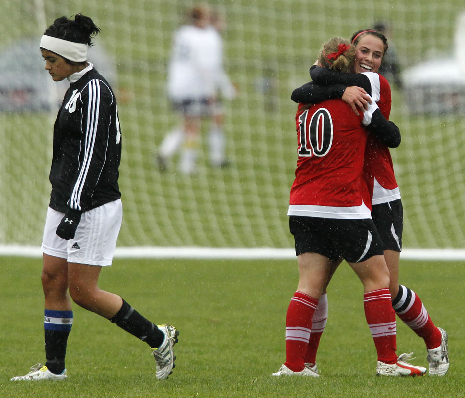 Cheyenne Central's Makena Cameron, right, hugs teammate Halee Moore (10) as Cheyenne East's Victoria Arenas walks back towards the bench following a goal from Cameron during a Class 4A girl's state soccer third place game on Saturday, May 21, 2011, in Sheridan, Wyo.