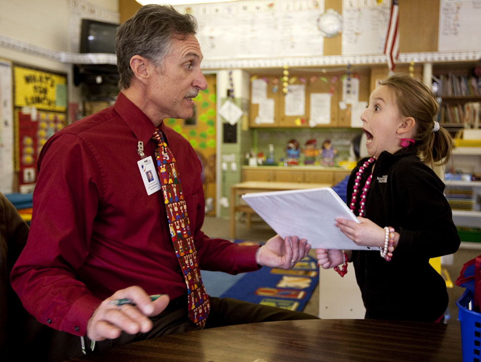 """Aspen Rewerts, right, a kindergarten student at Jessup Elementary, reacts before hugging Mark Stock, superintendent of Laramie County School District No. 1, after Stock checked her work before recess on Thursday, March 24, 2011, at the school. Stock was teaching in place of Kathleen Blaes-Garcia for the day after Blaes-Garcia won a contest for donating to the Cheyenne School Foundation. """"It's been refreshing,"""" said Stock, who taught third and sixth graders for eight years before becoming an administrator. (James Brosher/Wyoming Tribune Eagle)"""