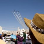 Spectators watch as the U.S. Air Force Thunderbirds fly over Laramie County Community College as they make their entrance for a performance coinciding with Cheyenne Frontier Days on Wednesday, July 27, 2011. (James Brosher/Wyoming Tribune Eagle)