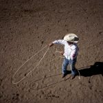 Paul Tierney from Oral, S.D. practices his roping behind chute 9 during Cheyenne Frontier Days steer roping on Friday, July 22, 2011, at Frontier Park. (James Brosher/Wyoming Tribune Eagle)