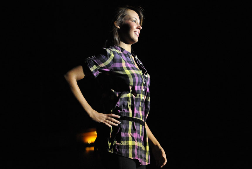 A student model shows off an outfit from Victoria's Secret Pink Collegiate Collection during a fashion show on Thursday, Nov. 5, 2009, in the IMU's Alumni Hall.