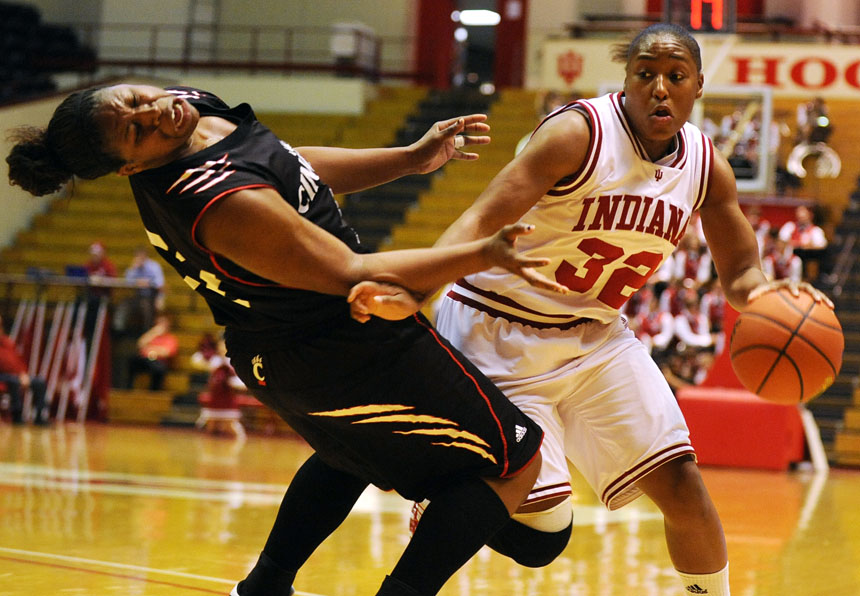 IU guard Jori Davis makes contact with Cincinnati forward Michelle Jones during a game on Wednesday, Nov. 18, 2009, at Assembly Hall.