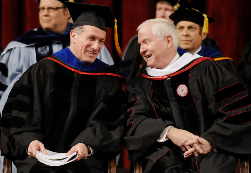 U.S. Secretary of Defense Robert Gates, right, shares a laugh with Bennettt Bertenthal, the dean of the College of Arts and Sciences, on stage during IU's Winter Commencement Exercises on Saturday, Dec. 19, 2009, at Assembly Hall.