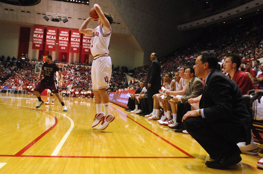 IU coach Tom Crean, right, watches  as guard Jordan Hulls shoots a three pointer from the corner during a game on Saturday, Dec. 19, 2009, at Assembly Hall. IU won 81-58.