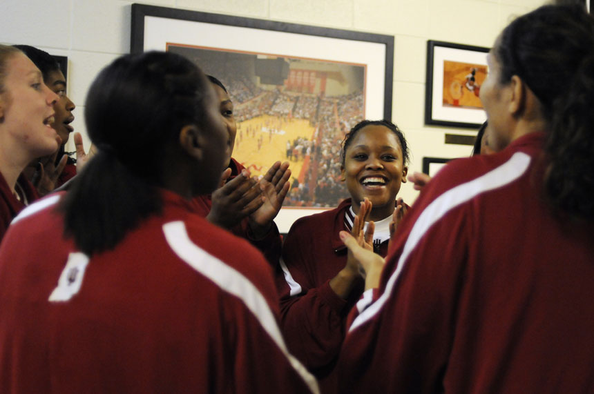 Indiana guard Andrea McGuirt, middle, sings the IU Fight Song along with her teammates before taking the court to warmup before a game against Ohio State on Sunday, Jan. 31, 2010, at Assembly Hall.