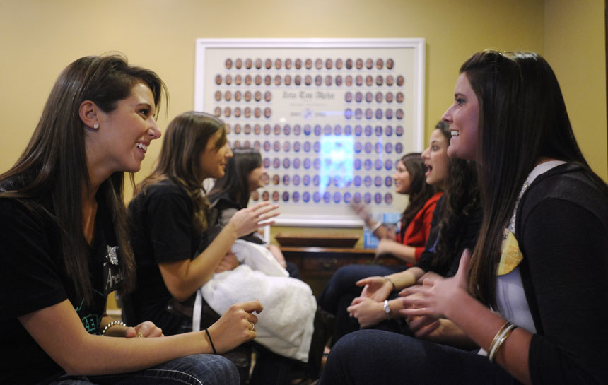 Potential new members, right row, speak with Zeta Tau Alpha sisters, left row, during 14 Party on Thursday, Jan. 7, 2010, at the Zeta Tau Alpha house. The two-day event allows potential new members to meet women from different chapters.
