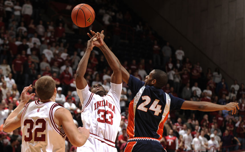 IU guard Devan Dumes (33) tips a pass intended for Illinois forward Mike Davis during a game on Saturday, Jan. 9, 2010, at Assembly Hall.