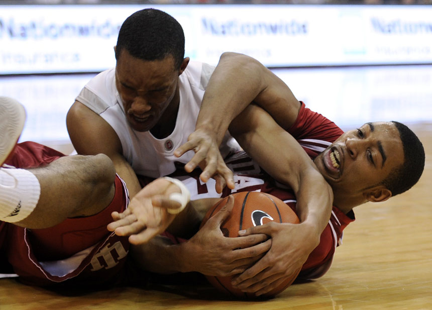 IU forward Christian Watford, right, struggles for a loose ball with Ohio State guard/forward Evan Turner during a game on Wednesday, Jan. 6, 2010, in Columbus, Ohio.