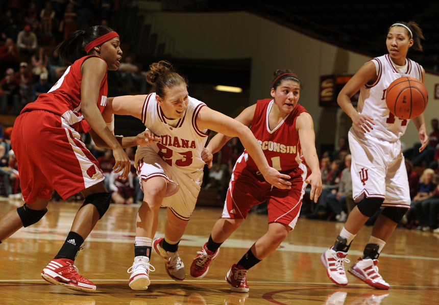 Indiana guard Jamie Braun (23) struggles  to grab the ball after it was knocked away by a Wisconsin defender during a game on Thursday, Jan. 28, 2010, at Assembly Hall.