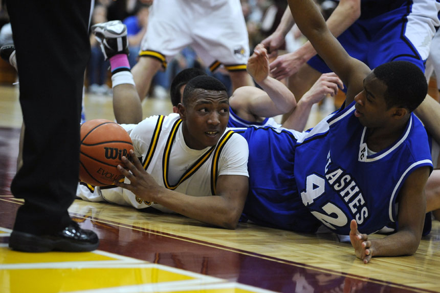 North's D.J. Brown, left, looks to make a pass from the floor during a game on Friday, Jan. 29, 2010, at Bloomington North.