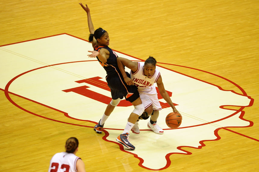 IU guard Jori Davis, right, draws contact from Illinois forward Lacey Simpson during a NCAA women's basketball game on Thursday, Jan. 7, 2010, at Assembly Hall. IU won 50-48.