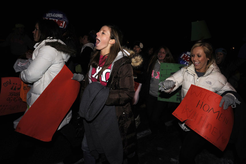 Alpha Chi Omega rush towards a bus carrying new members during Bid Day on Monday, Jan. 11, 2010, outside the chapter's Jordan Avenue house.