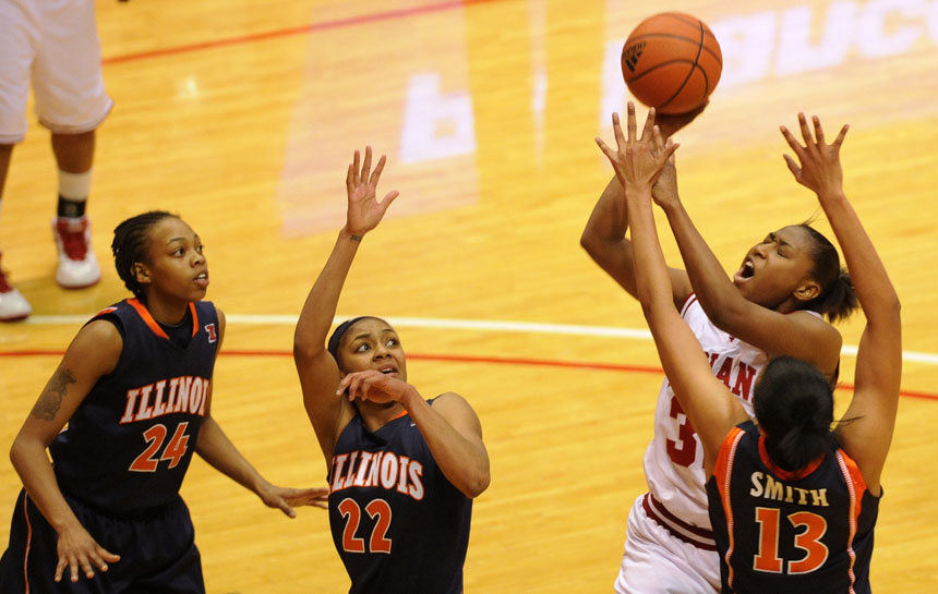IU guard Jori Davis reacts as she draw contact from Illinois center Jenna Smith (13) during a NCAA women's basketball game on Thursday, Jan. 7, 2010, at Assembly Hall. IU won 50-48.