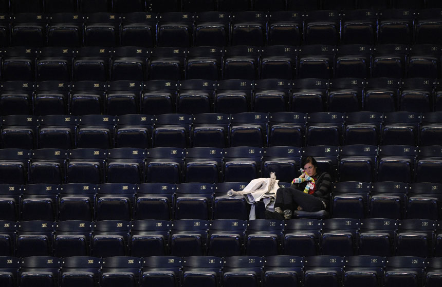 A lone fan watches the action from an empty section during a NCAA women's basketball game between IU and Illinois on Thursday, Jan. 7, 2010, at Assembly Hall. Bad weather and Christmas break contributed to an extremely sparse crowd at the game although the official attendance was listed at 1,350.
