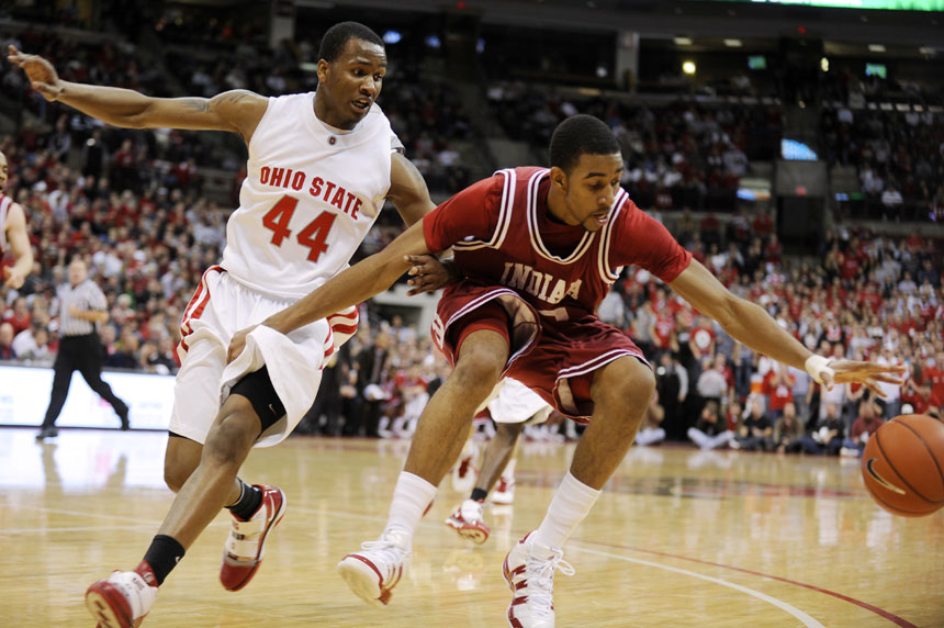 IU forward Christian Watford attempts to grab a loose ball in front of Ohio State guard William Buford during a game on Wednesday, Jan. 6, 2010, in Columbus, Ohio.