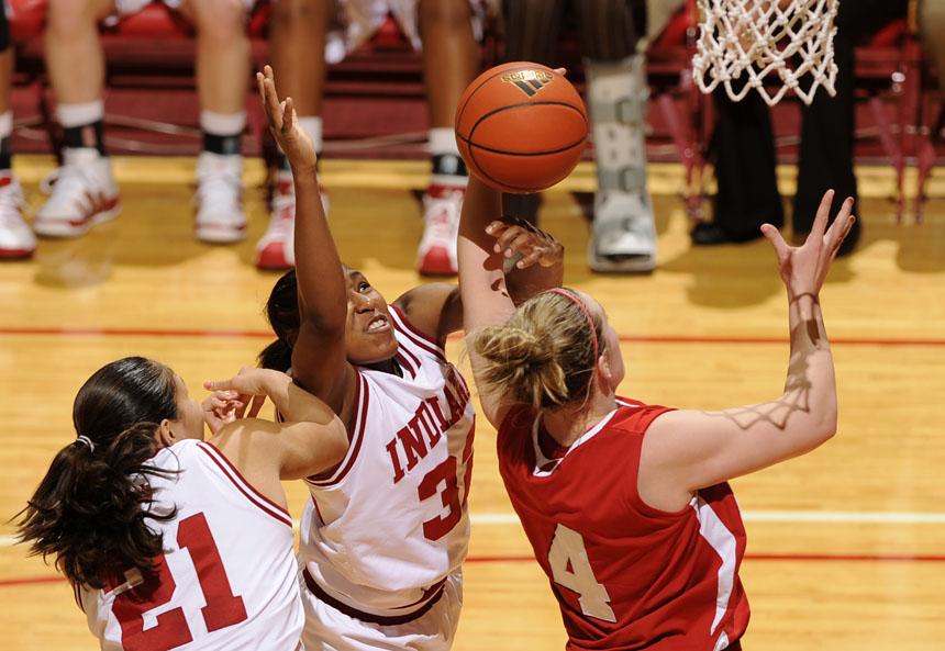 Indiana forward Danilsa Andujar (21) and guard Jori Davis (32) battle for a rebound against Wisconsin center Tara Steinbauer during a game on Thursday, Jan. 28, 2010, at Assembly Hall.