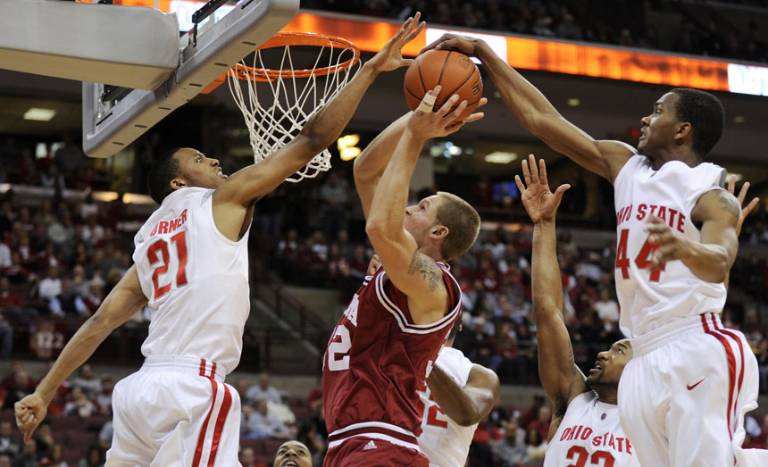 Ohio State guard/forward Evan Turner (21) and guard William Buford (44) block a shot from IU forward Derek Elston during a game on Wednesday, Jan. 6, 2010, in Columbus, Ohio.
