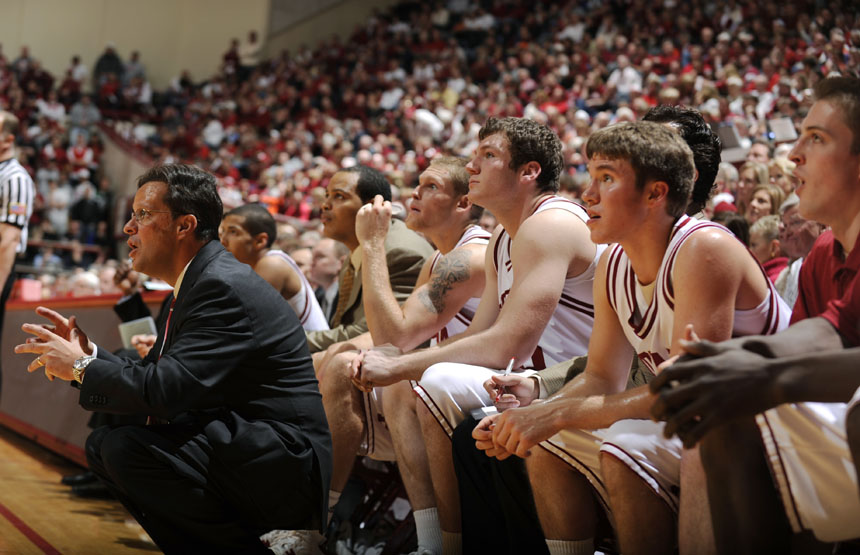 IU coach Tom Crean watches with his bench as a shot goes up late in the second half of a game on Saturday, Jan. 9, 2010, at Assembly Hall. IU lost 66-60.