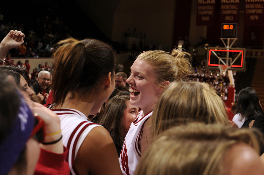 Indiana forward Aulani Sinclair celebrates with fans on the court after IU upset No. 4 Ohio State in a game on Sunday, Jan. 31, 2010, at Assembly Hall. IU won 67-62.