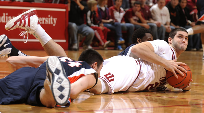 IU forward Bobby Capobianco, right, struggles to grab a loose ball on the floor during a game on Saturday, Jan. 9, 2010, at Assembly Hall. IU lost 66-60.