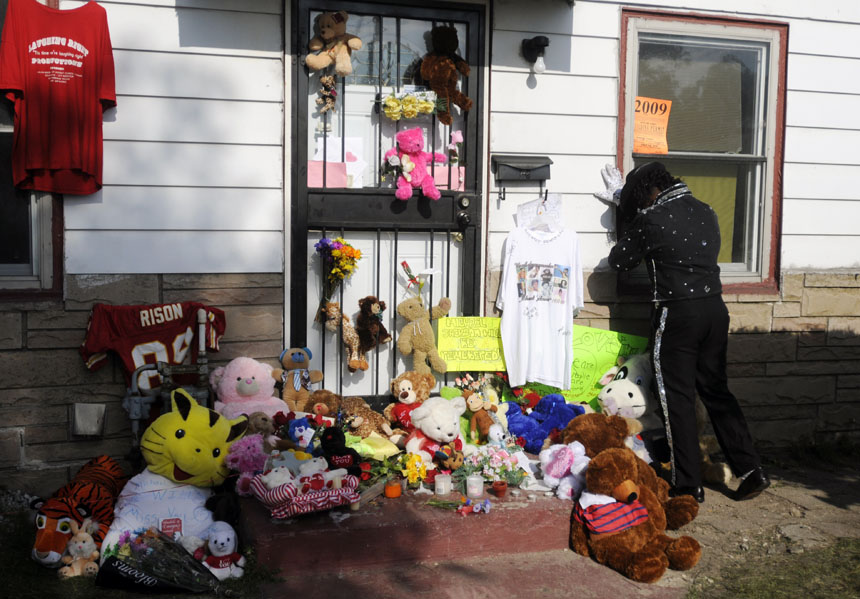 Impersonator Anthony Wilson, of Calumet Park, Ill., pauses for a moment to mourn on Friday, June 26, 2009, in front of Michael Jackson's childhood home in Gary, Ind. The pop star died on Thursday in Los Angeles.