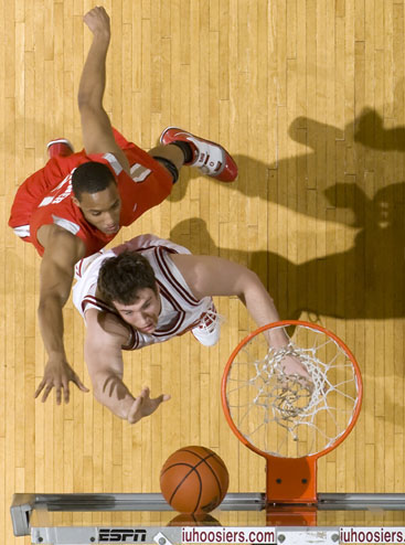 Indiana forward Tom Pritchard, bottom, puts up a shot  off the glass in front of Ohio State guard/forward Evan Turner during a game on Wednesday, Feb. 10, 2010, at Assembly Hall in Bloomington, Ind. (James Brosher / For The Star)