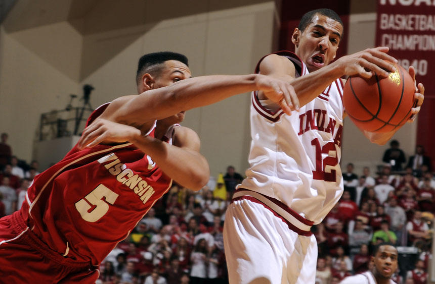 Indiana guard Verdell Jones III snatches a rebound away from Wisconsin guard/forward Ryan Evans during a game on Thursday, Feb. 25, 2010, at Assembly Hall in Bloomington, Ind.