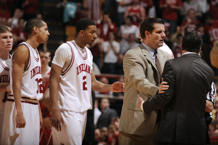 Indiana assistant coach Tim Buckley, second from right, restrains coach Tom Crean after Crean received a second technical foul, ejecting him from a game against Wisconsin on Thursday, Feb. 25, 2010, at Assembly Hall in Bloomington, Ind. IU lost 78-46.