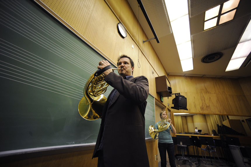 IU professor Jeff Nelsen participates in a warmup exercise with his students, including junior Jenny Smoak in background, during a class on Saturday, Feb. 6, 2010, at the Jacobs School of Music.