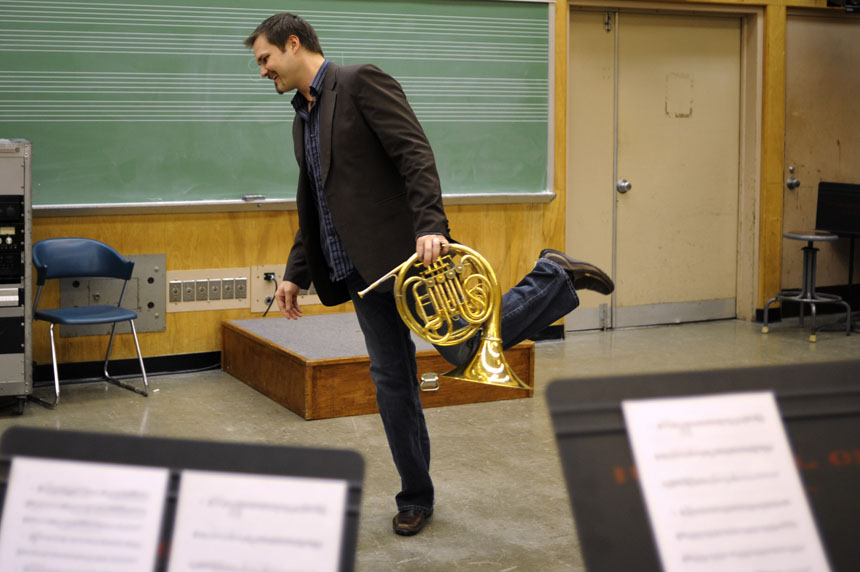 """IU professor Jeff Nelsen walks off the """"stage"""" after a mock audition performance for his students during a class on Saturday, Feb. 6, 2010, at the Jacobs School of Music. Nelsen teaches a class to help music students combat stage fright associated with audition performances."""