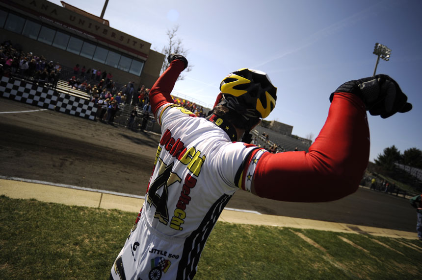 Delta Chi rider Ryan Meneghin flexes his muscles to the crowd as the fraternity's fan section erupts in cheers before the team's Little 500 qualifying attempt on Saturday, March 27, 2010, at Bill Armstrong Stadium.