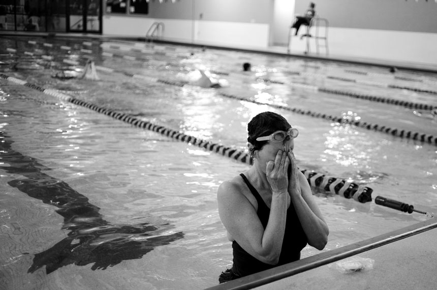 Sharlee Davis wipes water out of her eyes after swimming a mile on Saturday, Feb. 27, 2010, at the Monroe County YMCA. Davis says it takes her around 40 minutes to swim a mile in the pool, an activity she does three to four times a week.