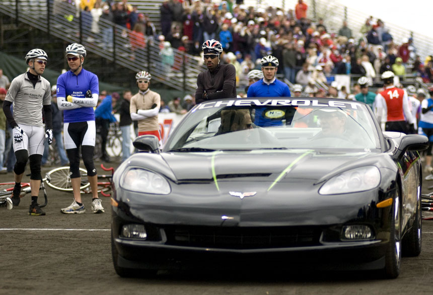 Riders try to stay warm as the pace car gets ready to roll off the starting grid during the Men's Little 500 race Saturday at Bill Armstrong Stadium.