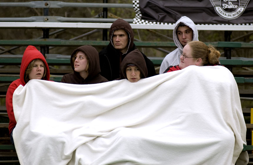 Fans try to stay warm during the Men's Little 500 race Saturday at Bill Armstrong Stadium. Temperatures dipped into the 40s during the race.