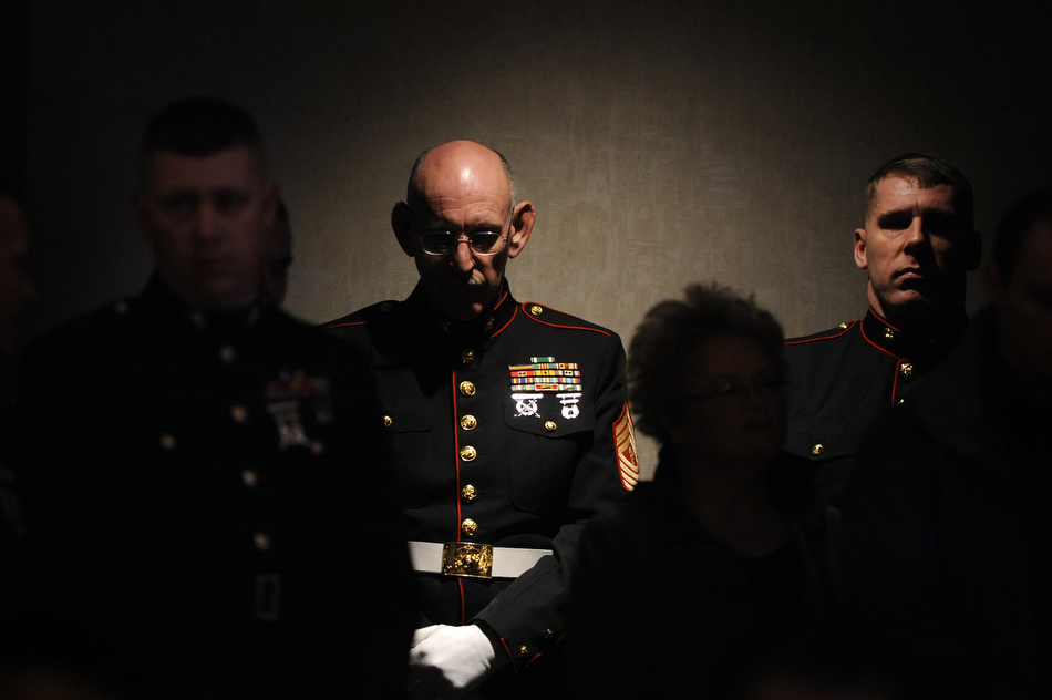 Master Gunnery Sgt. John Lund, a member of the Marine honor guard, listens to a memorial ceremony for Sgt. Jeremy McQueary on Sunday, Feb. 28, 2010, at The Seasons Lodge and Conference Center in Nashville, Ind. Lund, a veteran of the Vietnam War, Gulf War and Iraqi War, folded a flag in McQueary's ceremony. McQueary, 27, was killed in the Helmand Province in Afghanistan on Feb. 18.