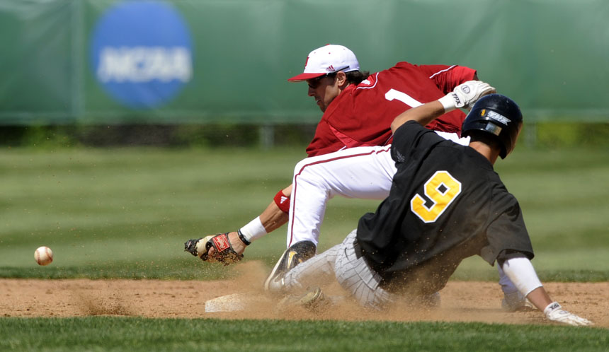 Iowa's Trevor Willis (9) slides into second as an outfielder overthrows Indiana's Tyler Rogers (1) during a game on Sunday, April 18, 2010, at Sembower Field.