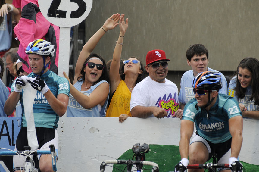 A few fans take part in a team chant during a heavy rain behind the Emanon pit during the Men's Little 500 on Saturday, April 24, 2010, at Bill Armstrong Stadium.