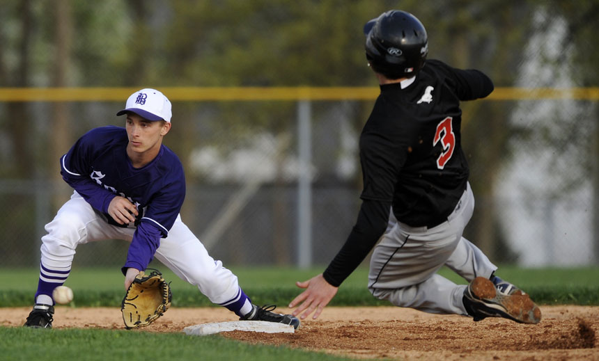 South's Kevin Swango scoops up the throw from home as Edgewood's Kaleb Shute (3) slides into second in an attempt to steal the base during a game on Thursday, April 8, 2010, at Bloomington High School South. Shute was safe on the play.