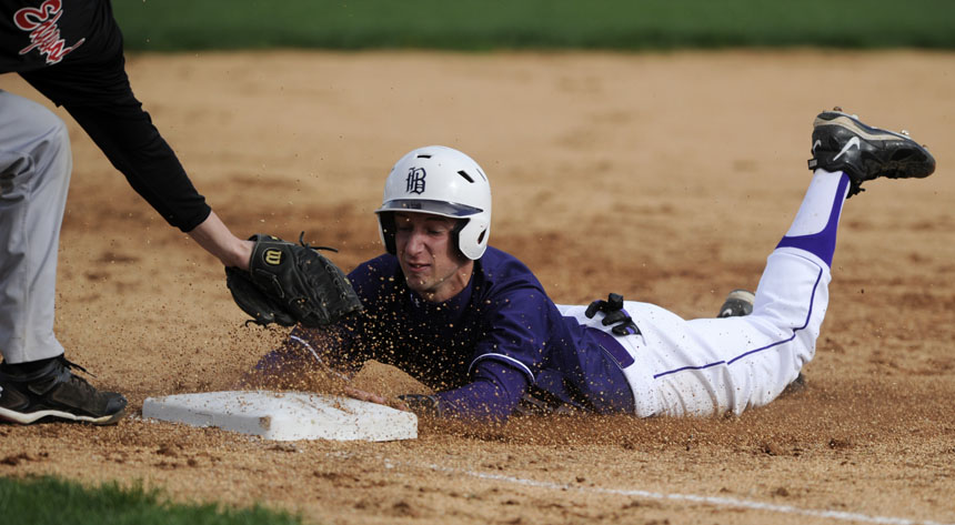 South's Derek Gross slides safely into third base after making a steal during a game against Edgewood on Thursday, April 8, 2010, at Bloomington High School South. South won 8-3.
