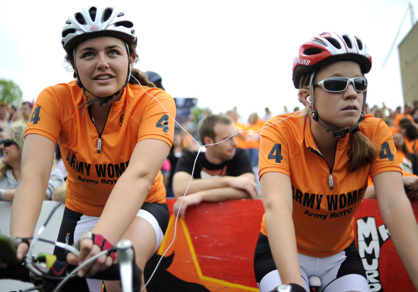 """Army riders Aileen Ottenweller, left, and Rachel Stark share an iPod as they warm up before the start of the Women's Little 500 on Friday, April 23, 2010, at Bill Armstrong Stadium. The teammates were listening to """"All I Do Is Win"""" by DJ Khaled."""